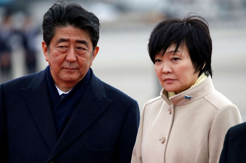 Japan's Prime Minister Shinzo Abe and his wife Akie at Haneda Airport in Tokyo, Japan on Feb 28, 2017.