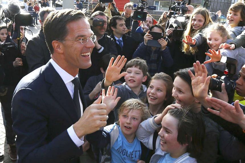 Dutch Prime Minister Mark Rutte greets supporters after voting in the general election in The Hague, Netherlands, March 15, 2017.