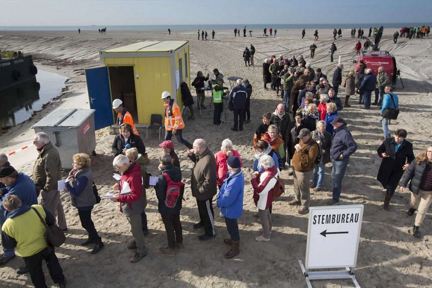Dutch voters waiting in line to cast their vote to elect a new government, during the parliamentary elections on the new island Marker Wadden, in the Netherlands, on March 15, 2017.