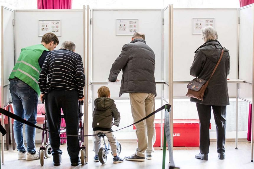 Dutch voters casting their vote during a parliamentary elections at the polling station in Rotterdam, the Netherlands, on March 15, 2017