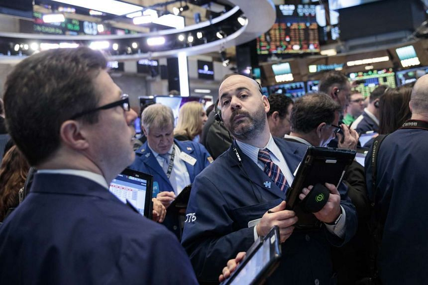 Traders and financial professionals work on the floor of the New York Stock Exchange, March 15, 2017.