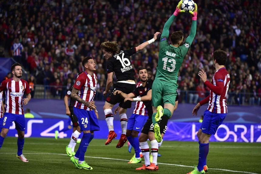 Atletico Madrid's Slovenian goalkeeper Jan Oblak stops a ball during the UEFA Champions League round of 16 second leg football match Club Atletico de Madrid vs Bayer Leverkusen at the Vicente Calderon stadium in Madrid on March 15, 2017