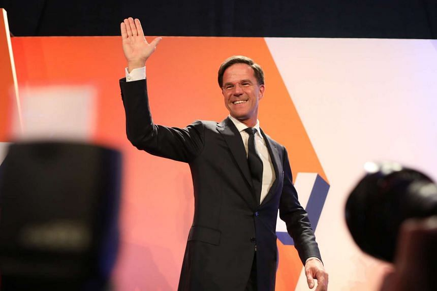 Mark Rutte, Dutch prime minister and leader of the Liberal Party (VVD), waves to supporters in The Hague, Netherlands, on Wednesday, March 15, 2017.