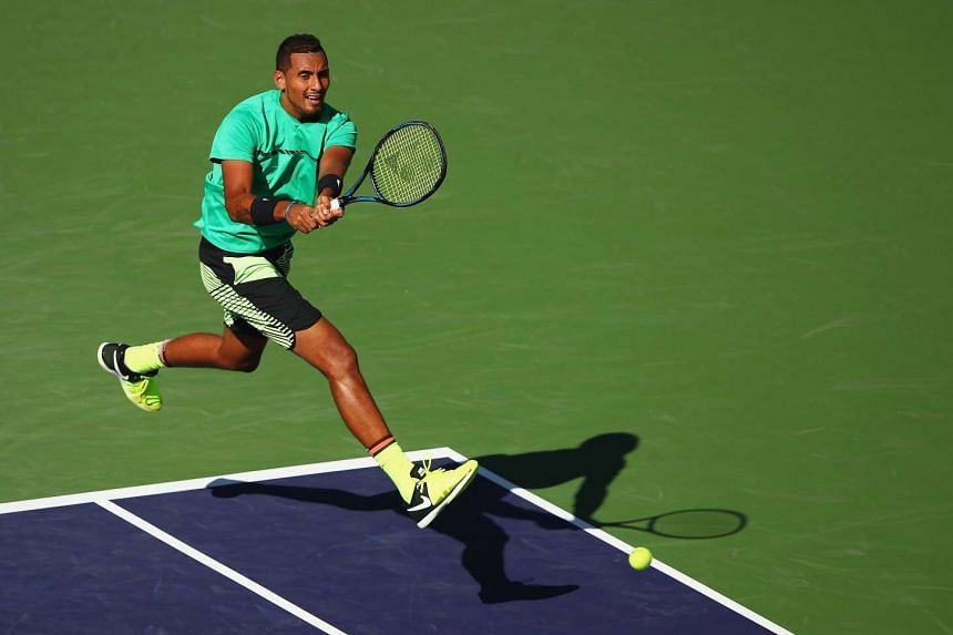 Nick Kyrgios of Australia playing a backhand during his straight set victory against Novak Djokovic (not pictured) in their fourth round match during day ten of the BNP Paribas Open, on March 15, 2017.