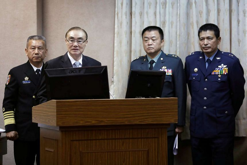 Taiwan Defence Minister Feng Shih-kuan (second from left) attends a parliamentary session at Legislative Yuan in Taipei, on March 16, 2017.