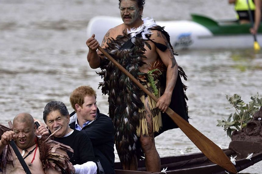 """File photo taken in 2015 of Britain's Prince Harry (second from right) in a waka (Maori war canoe) on the Whanganui river. The New Zealand river has been recognised by parliament as a """"legal person""""."""
