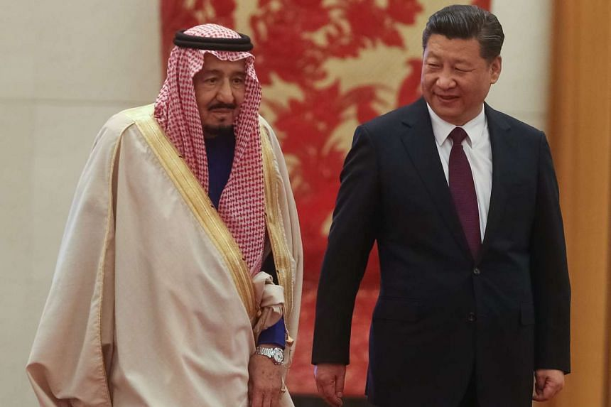 Chinese President Xi Jinping and Saudi Arabia's King Salman bin Abdulaziz Al Saud during a welcoming ceremony at the Great Hall of the People in Beijing, China, on March 16, 2017.