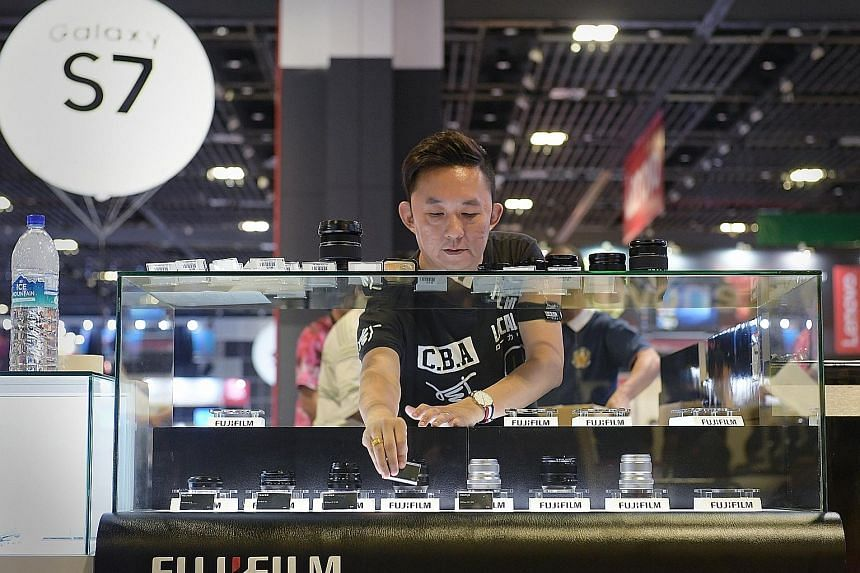 FujiFilm Asia-Pacific's senior product specialist Rick Tan setting up his company's booth at the IT Show 2017.