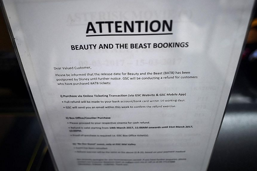 "A notice put up at a Golden Screen Cinemas theatre in Kuala Lumpur regarding the ""postponed"" release of the Disney movie, Beauty And The Beast, and ticket refunds."
