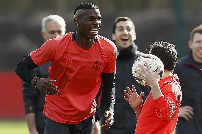 Paul Pogba enjoying a light moment at training yesterday. Manchester United take on Rostov at Old Trafford in a Europa League second leg clash today and Jose Mourinho has said the world's most expensive player is unaffected by criticism of his perfor