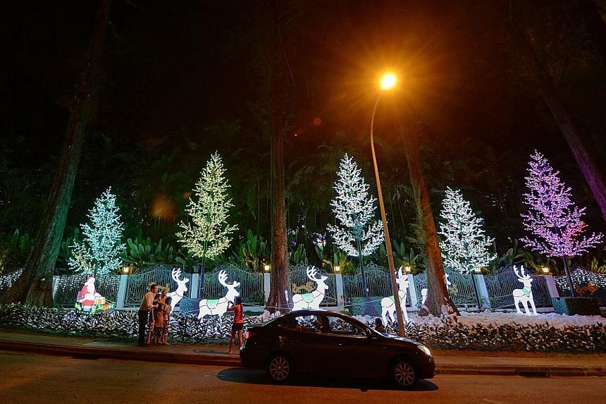 The decorations for Francis' 2010 Christmas party, thrown annually at his Nassim Road bungalow (left), were reported to have cost $100,000.