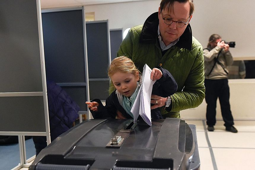 A ballot being cast at The Hague. The election will be a litmus test for right-wing firebrand Geert Wilders and his supporters.