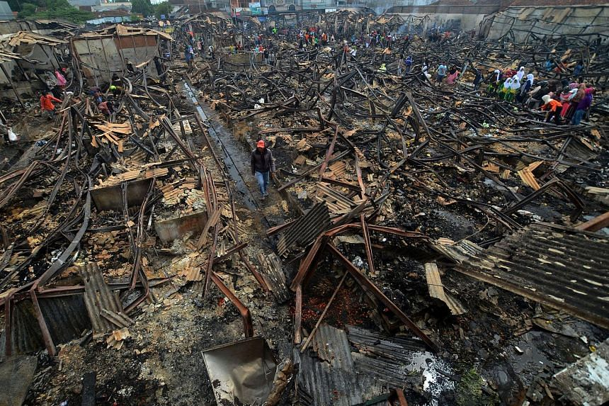 The Manonjaya market in Tasikmalaya, West Java, Indonesia, was destroyed during an overnight fire yesterday. A witness said the fire, which shop owners blamed on an electrical short-circuit, spread quickly, burning 300 kiosks in just half an hour. Th