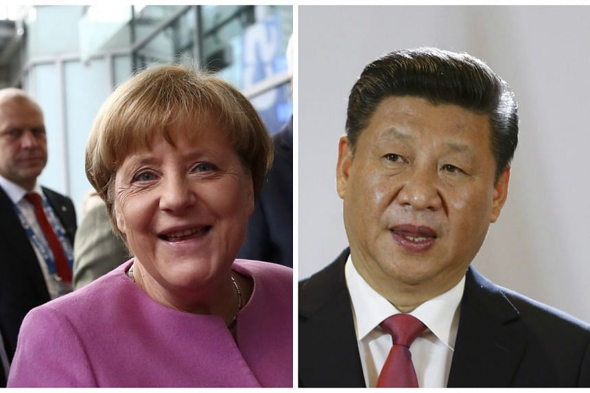 "Merkel (left) and Xi spoke by telephone and said in a statement they would ""together fight for free trade and open markets""."