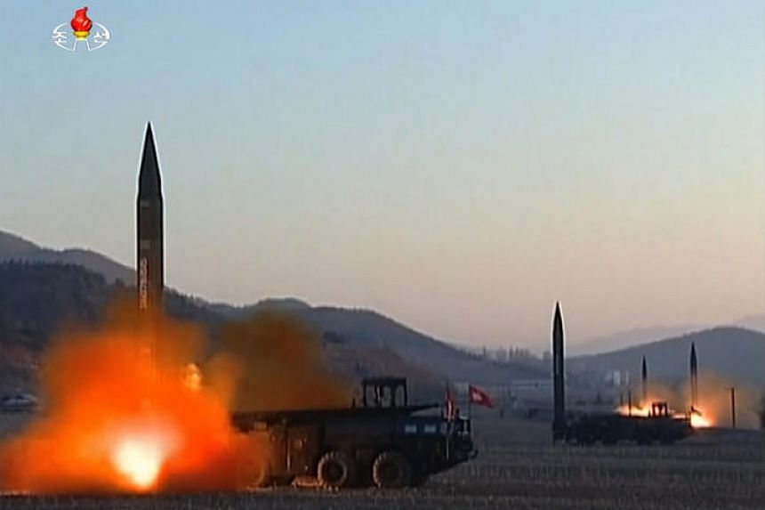 This screen grab taken from North Korean broadcaster KCTV on March 7, 2017, shows ballistic missiles being launched during a military drill from an undisclosed location in North Korea.  The North launched four ballistic missiles on March 6, 2017, wi