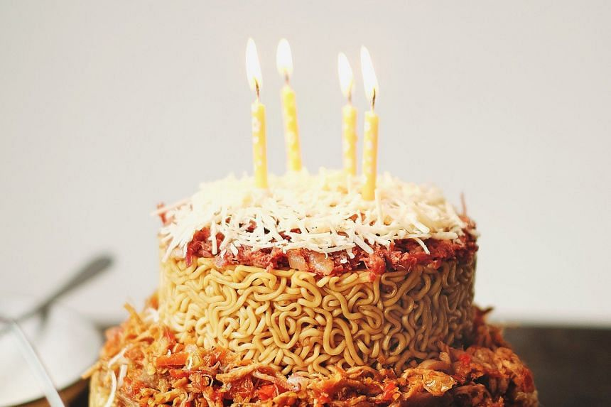 TOT.Aw's two-tier noodle cake is made from 14 to 17 packs of instant noodles. PHOTO: THE JAKARTA POST