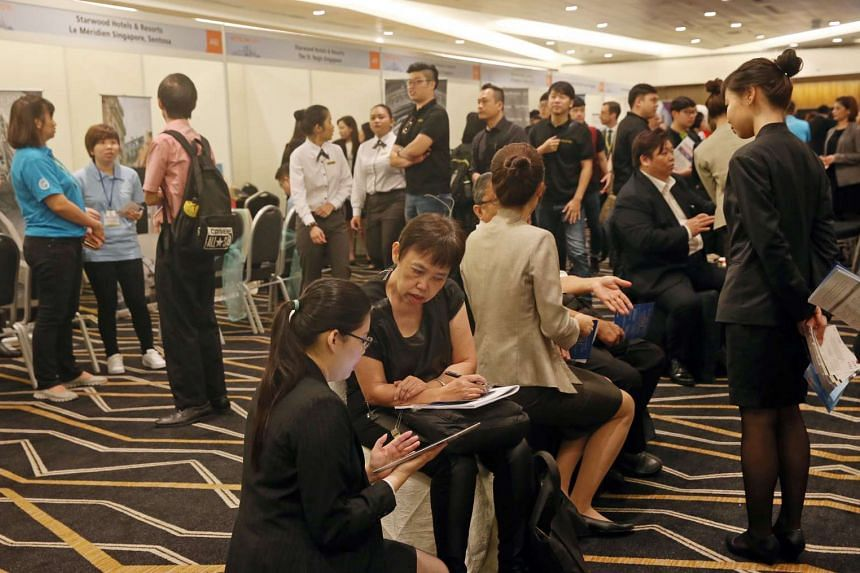 Job seekers at the hotel career fair held on September 23, 2016. The hotel sector, which employs 35,000 people, has about 2,100 vacancies, of which 40 per cent are for professionals, managers, executives and technicians (PMETs).