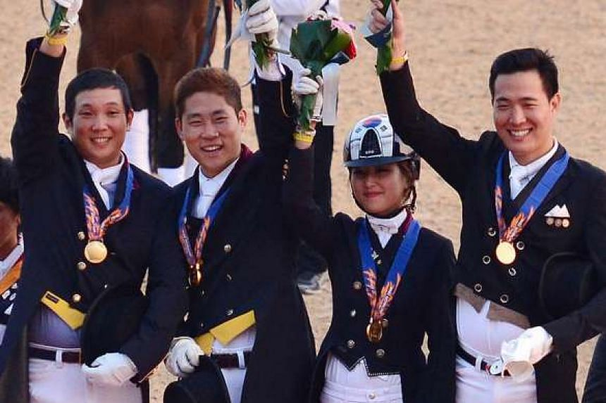 Chung Yoo Ra (second from right) and her teammates receiving gold medals at the Asian Games in Incheon, South Korea, in 2014.