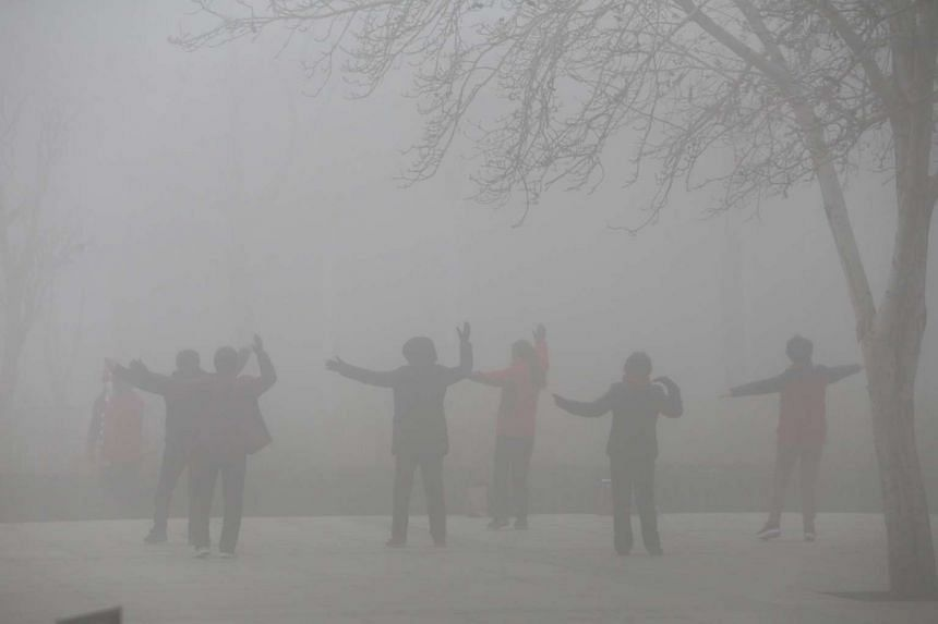 People exercise in the smog on a polluted day in Zhengzhou, Henan province, China on Jan 9, 2017.