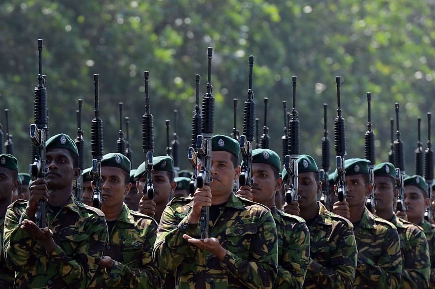 Sri Lankan military personnel take part in an Independence Day parade rehearsal in Colombo on Feb 1, 2017.