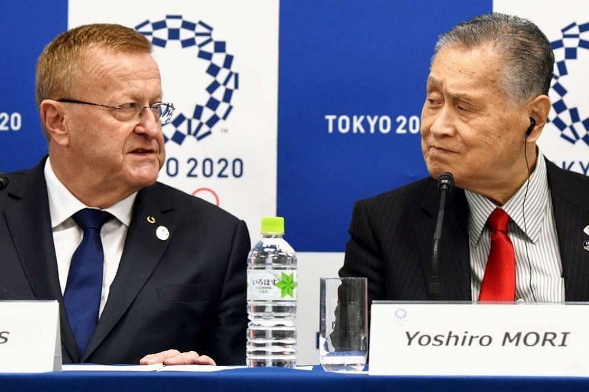 John Coates (left), the International Olympic Committee (IOC) Vice President and Chairman of the IOC Cordination Commission for the Tokyo 2020 Olympic Games, answers questions beside Yoshiro Mori, president of the Tokyo 2020 Organising Committee, dur