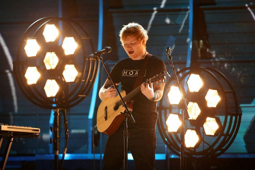 Ed Sheeran performs at the 59th Annual Grammy Awards in Los Angeles.