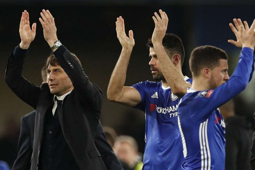 Chelsea manager Antonio Conte celebrates after a match with Eden Hazard and Diego Costa.