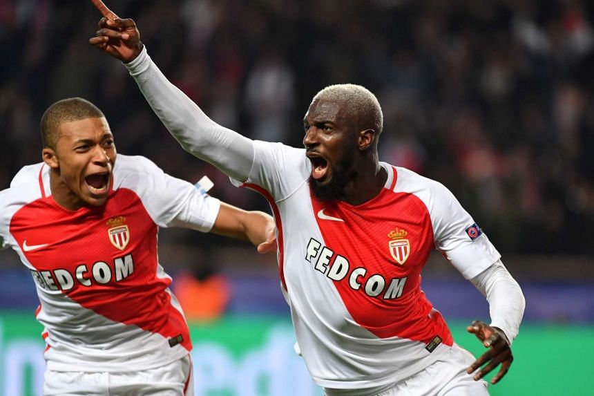 Monaco's French midfielder Tiemoue Bakayoko celebrating with forward Kylian Mbappe Lottin (left) after scoring a goal during the UEFA Champions League round of 16 football match against Manchester City in Monaco on March 15, 2017.