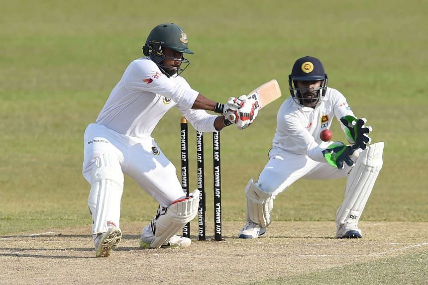 Bangladesh cricketer Imrul Kayes (left) playing a shot as Sri Lankan wicketkeeper Niroshan Dickwella looks on during the second day of the second and final Test cricket match between Sri Lanka and Bangladesh at The P. Sara Oval Cricket Stadium in Col