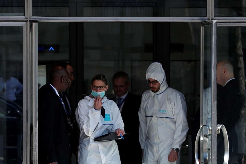 Members of the scientific Police leave the International Monetary Fund (IMF) offices where an envelope exploded in Paris, France on March 16, 2017.