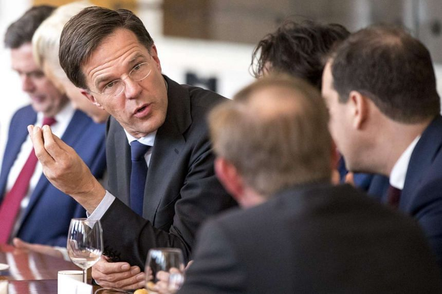 Dutch Prime Minister Mark Rutte (left) during a meeting between main parties leaders and the Chairman of the Senate in The Hague after the general elections on March 16, 2017.