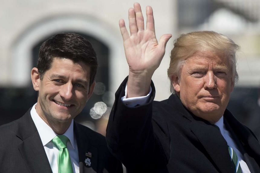 US President Donald Trump waves alongside Speaker of the House Paul Ryan at the US Capitol, March 16, 2017.