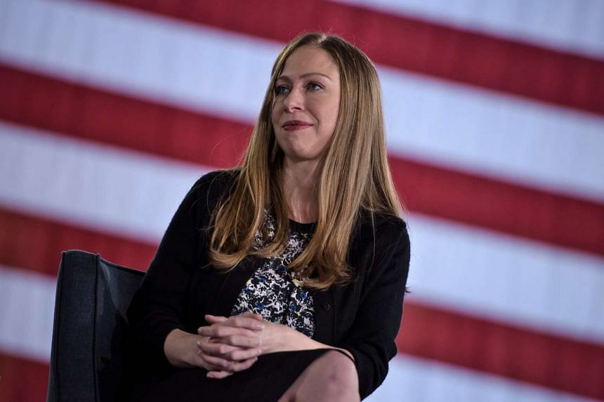Chelsea Clinton listens to mother Hillary Clinton at a town hall meeting in Pennsylvania on Oct 4, 2016.