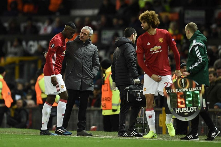 Paul Pogba (left) talking with Jose Mourinho (centre) as he leaves the pitch injured.