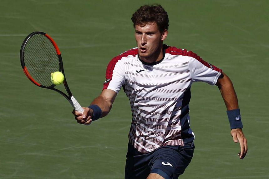 Pablo Carreno Busta of Spain returns a shot against Pablo Cuevas of Uruguay during their quarter final match at the 2017 BNP Paribas Open tennis tournament at the Indian Wells Tennis Garden in Indian Wells, California, USA on March 16, 2017.