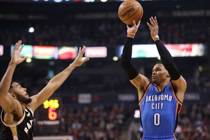 Oklahoma City Thunder point guard Russell Westbrook shoots as Toronto Raptors point guard Cory Joseph defends at Air Canada Centre on March 16, 2017.