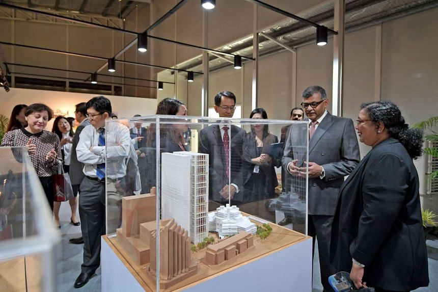 Judge of the State Courts Justice See Kee Oon (fourth from right), The Honourable Chief Justice Sundaresh Menon (second from right), and Deputy Presiding Judge of the State Courts Jennifer Marie (right) view a model of the new State Courts Towers on