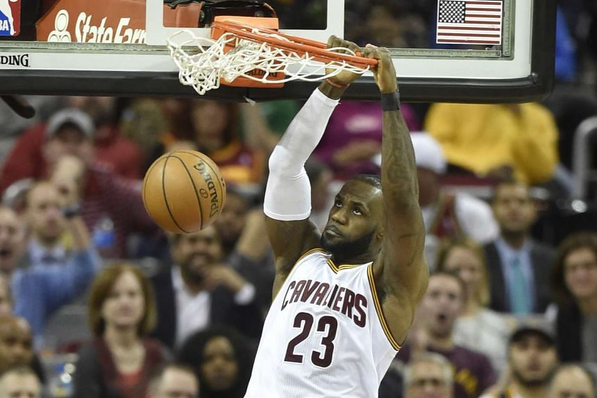 Cleveland Cavaliers forward LeBron James (23) dunks in the fourth quarter against the Utah Jazz at Quicken Loans Arena on March 16, 2017.