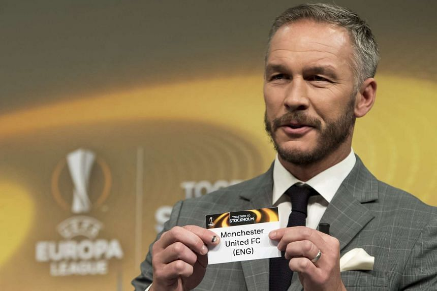 Former Swedish soccer player Patrik Andersson and ambassador for the UEFA Europa League final in Stockholm, shows a ticket with British soccer team Manchester United during the quarter-final draw of the UEFA Europa League 2016/17 on March 17, 2017.
