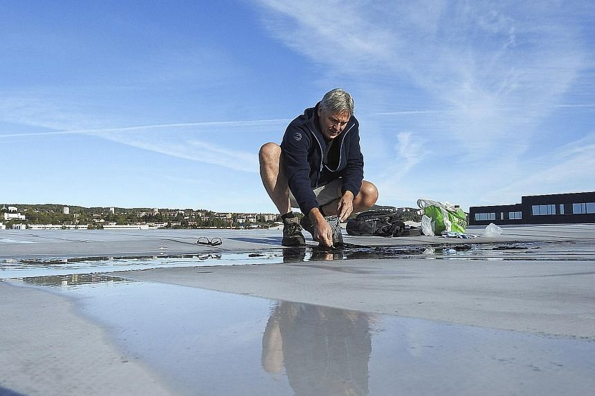 Jazz musician Jon Larsen searching for micrometeorites on a roof. He is part of an international team which found that rooftops and other cityscapes readily collect cosmic debris in ways that can ease its identification. Varieties of extraterrestrial