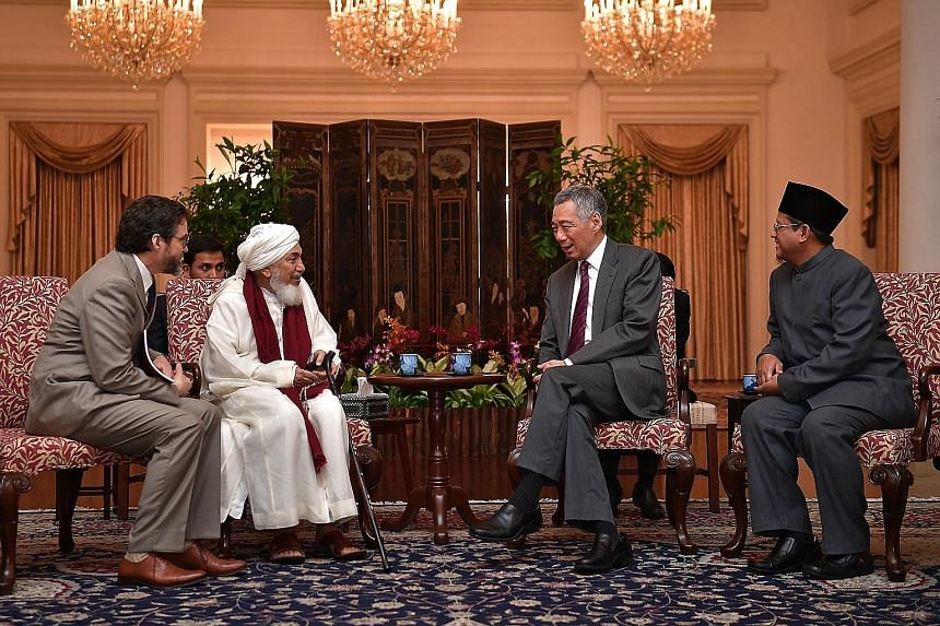 Shaykh Abdallah Bin Bayyah, the president of the Forum for Promoting Peace in Muslim Societies, and the forum's vice-president Hamza Yusuf meeting Prime Minister Lee Hsien Loong and Singapore's Mufti Fatris Bakaram yesterday. The Shaykh is in Singapo