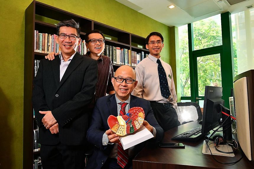 From left: Associate Professor Roger Foo and Dr Zhai Weiwei from the Genome Institute of Singapore, with Professor Pierce Chow (seated), from the National Cancer Centre Singapore, and Dr Wan Wei Keat from Singapore General Hospital. Their work sugges