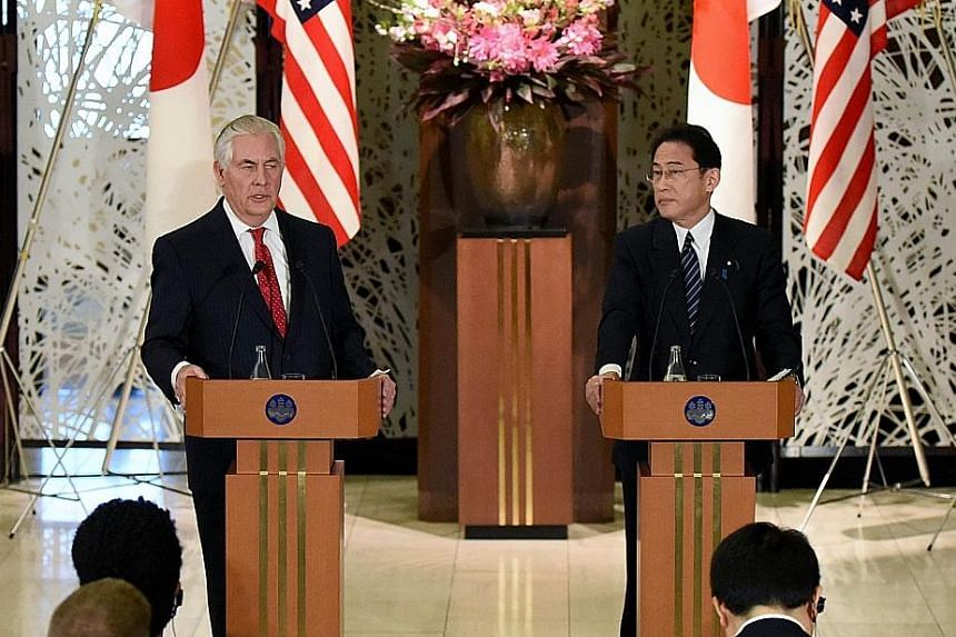 "US Secretary of State Tillerson and Japanese Foreign Minister Kishida at a joint news conference in Tokyo yesterday. Mr Tillerson talked of a ""new approach"" to Pyongyang after two decades of efforts failed to curb its nuclear ambitions."