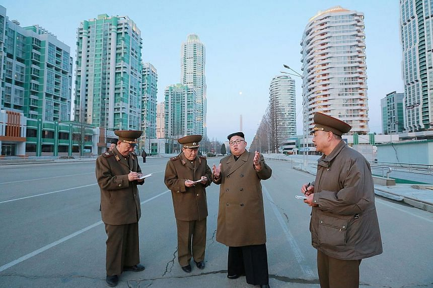 An undated photo showing North Korean leader Kim Jong Un in Ryomyong Street, Pyongyang. North Korea yesterday blamed the US and South Korea for the murder of his half-brother, Mr Kim Jong Nam.