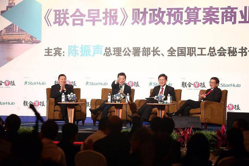 At the Lianhe Zaobao Singapore Budget Business Forum at Shangri-La Hotel yesterday was Minister in the Prime Minister's Office Chan Chun Sing (second from right). Mr Chan joined (from left) Mr Thomas Pek, Lianhe Zaobao editor Goh Sin Teck and Mr Rola