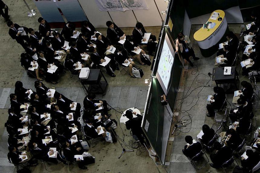 File photo of people attending a job fair held for fresh graduates in Tokyo, Japan.