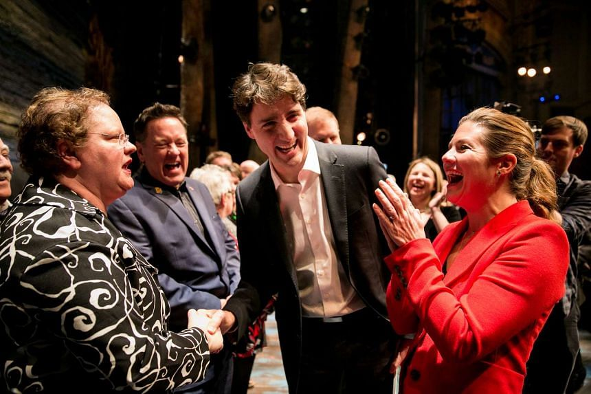 Canadian Prime Minister Justin Trudeau and his wife, Sophie Gregoire, greeting people whom the characters in Come From Away were based on after watching a performance of the show in New York, on Wednesday (March 15).