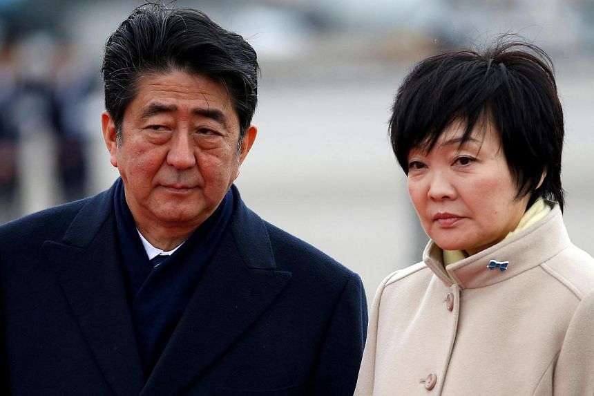 Japan's Prime Minister Shinzo Abe and his wife Akie at Haneda Airport in Tokyo, Japan, on Feb 28, 2017.