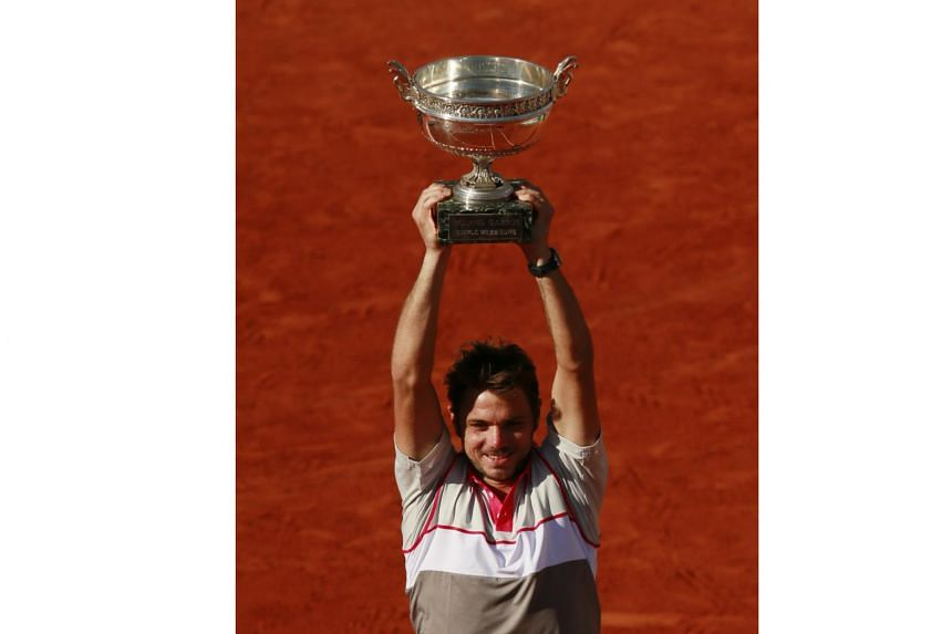Switzerland's Stanislas Wawrinka celebrates with the trophy after winning the final at the 2015 French Open.