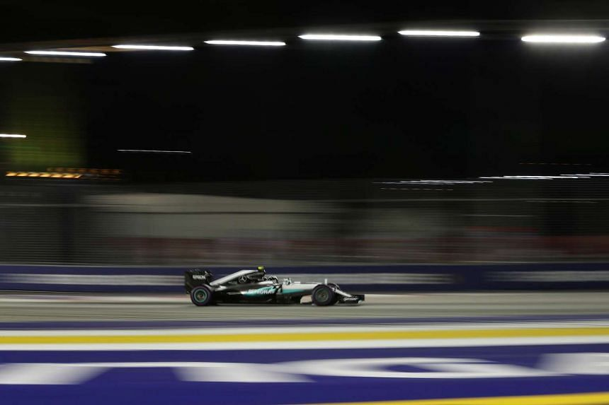 Mercedes AMG Petronas Formula One Team driver Nico Rosberg of Germany negotiating Turn 1 during the night race of the 2016 Formula One Singapore Airlines Singapore Grand Prix at the Marina Bay Street Circuit on 18 September 2016.